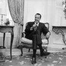 Harry Belafonte sitting on chair. - 8x10 photo