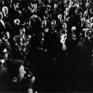 Geraldine Chaplin surrounded by people with cameras. - 8x10 photo
