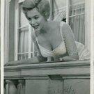 Marilyn Monroe at balcony. - 8x10 photo