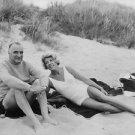 Georges Jean Raymond Pompidou lying with a woman on beach. - 8x10 photo