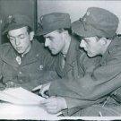 Three Norwegian volunteers studying the map of Finland, 1940. - 8x10 photo