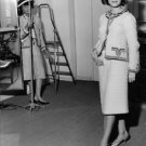 Coco Chanel looking at model. - 8x10 photo