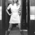 Ursula Andress standing on doorway.  - 8x10 photo