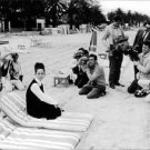 Geraldine Chaplin posing on a beach. - 8x10 photo