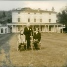 Charlie Chaplin standing, with wife Oona and daughter. - 8x10 photo