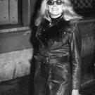 Catherine Deneuve wearing sunclasses. - 8x10 photo
