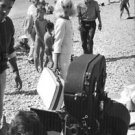 Jeane Moreau holding suitcase for a movie shot. - 8x10 photo