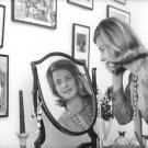Pia Lindström looking at mirror. - 8x10 photo