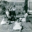 Hussein bin Talal playing with his children.  - 8x10 photo