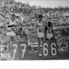 Sprinters Standing Behind their track numbers - 8x10 photo