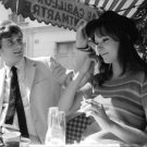 Anna Karina sitting with her husband. - 8x10 photo