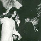Aristotle Onassis holding hand of Jacqueline Kennedy. - 8x10 photo