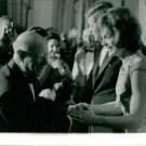 Jacqueline Kennedy holding hand of man. - 8x10 photo
