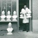 Man holding sculpture of Brigitte Bardot. - 8x10 photo