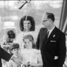 Jacqueline Kennedy standing with man and children. - 8x10 photo