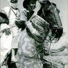 Man with his son doing horse riding. - 8x10 photo