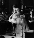 Maria Callas pampering a little girl. - 8x10 photo