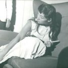 Juliette Greco sitting on sofa with book.  - 8x10 photo