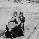 Catherine Deneuve and Omar Sharif on sledge. - 8x10 photo