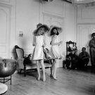 Catherine Deneuve and a woman having fun. - 8x10 photo