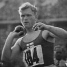 Olympics 1936. Man ready to throw ball. - 8x10 photo