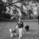 "Robert Francis ""Bobby"" Kennedy walking with his dog. - 8x10 photo"