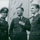 Three Airforce personnel having a conversation outside.- 1939 - 8x10 photo