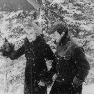 Catherine Deneuve and Jean-Paul Belmondo walking in snow. - 8x10 photo