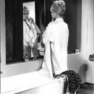 Brigitte Bardot looking at herself in the mirror. - 8x10 photo