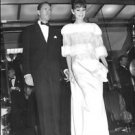 Audrey Hepburn with Mel Ferrer climbing down the stairs. - 8x10 photo