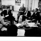 John F. Kennedy sitting on chair with people. - 8x10 photo