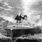 Catherine Deneuve and Sami Frey in motor boat. - 8x10 photo