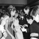 Audrey Hepburn and Mel Ferrer dancing with people. - 8x10 photo