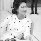 Maria Callas sitting, with sunglasses on table. - 8x10 photo