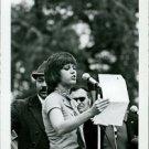 Jane Fonda reading at microphone. - 8x10 photo