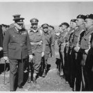 Winston Churchill inspects his old regiment in Cyprus. - 8x10 photo