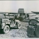 U.S. airborne troops load a jeep into the nose of a glider in preparation, landi