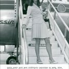 Elsa Martinelli standing on staircases of air plane. - 8x10 photo