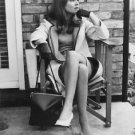 Julie Christie sitting on chair, looking up. - 8x10 photo