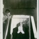 A young boy looking down on Enrico Caruso's body. - 8x10 photo