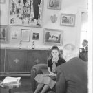 Maurice Auguste Chevalier in a conversation with a young girl. - 8x10 photo