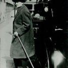 Bruno Kreisky wearing a long coat and holding a cane. - 8x10 photo