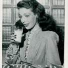 Loretta Young holding glass. - 8x10 photo