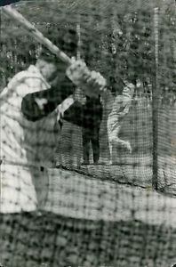 Baseball player ready to play a shot in net during practice and Marliyn Monroe l