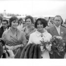 Elizabeth Taylor with people and holding bouquet. - 8x10 photo