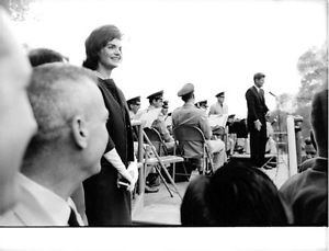 Jacqueline Kennedy Onassis standing and smiling. - 8x10 photo