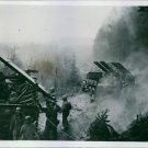 Battery A, 18th Field Artillery Battalion, First U.S. Army, reloads rocket launc