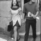Olivia Hussey laughing, walking with Leonard Whiting. - 8x10 photo