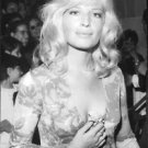 Monica Vitti at an event, posing with flower. - 8x10 photo