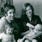 Eddy Merckx with his family, smiling.  - 8x10 photo
